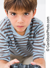 Little boy playing games console