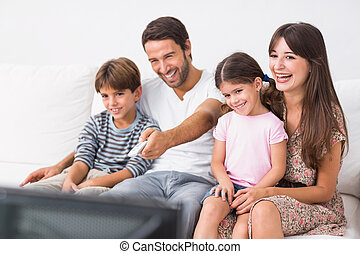 Happy family watching television