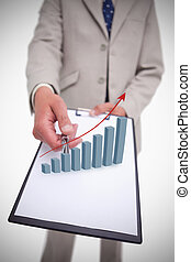 Businessman holding clipboard with