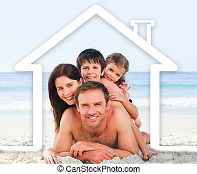 Family on the beach with a white ho
