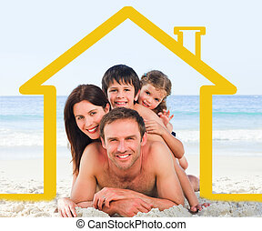 Family on the beach with yellow hou