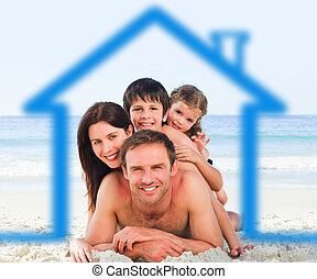 Family on the beach with blue house - Smiling family on the...