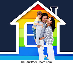 Embracing family standing with a house illustration with...