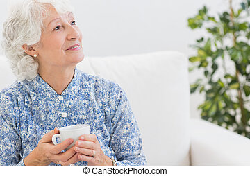 Elderly smiling woman looking away