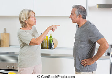 Couples dispute in the kitchen