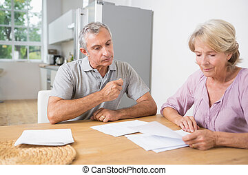 Couple reading documents together on a table