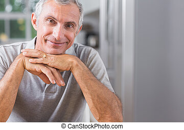 Portrait of smiling man looking at camera at home