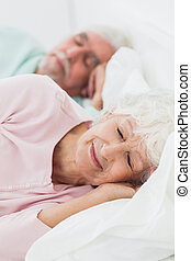 Elderly couple asleep