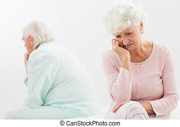 Couple not talking in bedroom - Elderly couple not talking...