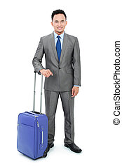 Man going on a business trip with bag - isolated over white...