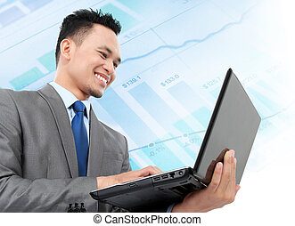 business man analyze - young business man using laptop while...