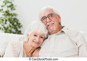 Elderly couple on couch