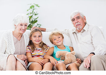 Children with their grandparents - Smiling children with...