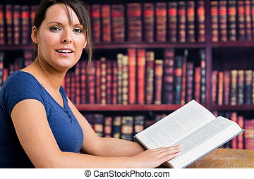 Girl smiling with book