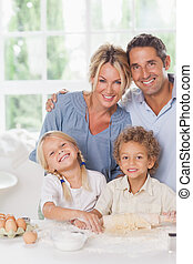 Mother and father baking with their children - Happy mother...