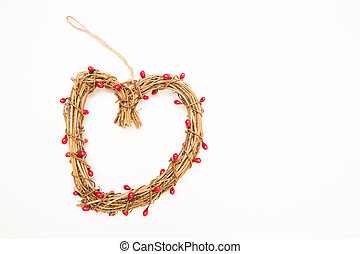 Straw heart shaped wreath on white background