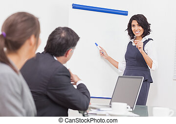 Businesswoman listening to a question and explaining with...