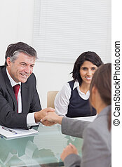 Two business people shaking hands as an agreement