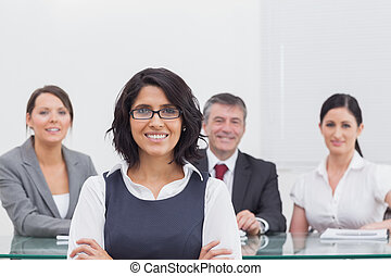 Four business people at a desk