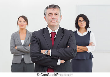 Businessman and his team standing
