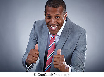 Sign of success - Happy businessman keeping his thumbs up...