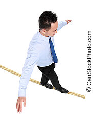 business challenge - businessman crossing the small rope...