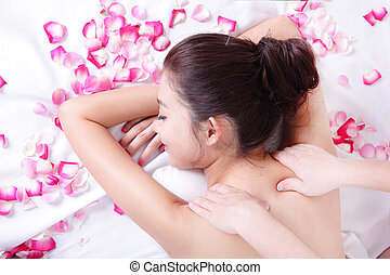 woman enjoying shoulder massage - asian woman beauty...