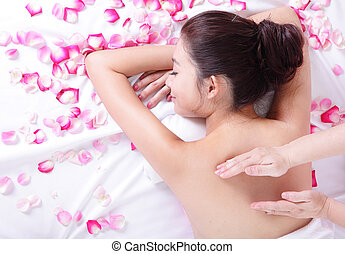 young woman getting massage and spa - young asian woman...