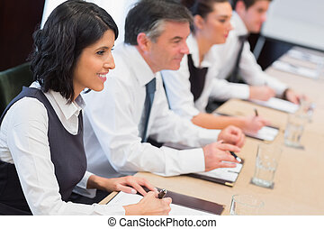 Smiling business team at a meeting