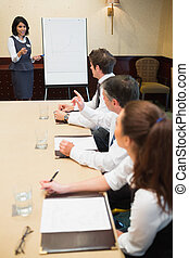 Businesswoman presenting ideas during meeting