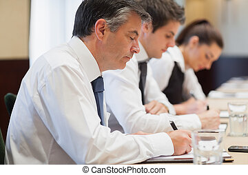 Writing business people during meeting
