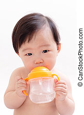 Baby drinking water from a bottle, asian child