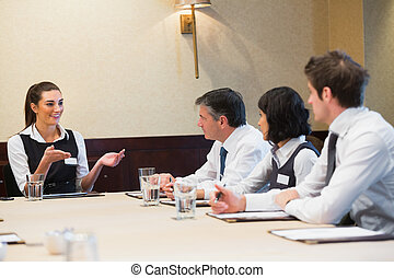 Businesswoman taking the lead during meeting