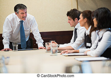 Angry boss in business meeting - Angry boss shouting in...