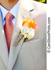 Groom Wedding Attire - A groom in a light-colored suit is...