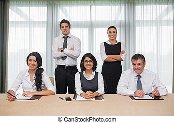 Cheerful business team in conference room