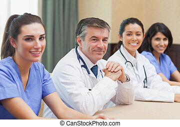 Smiling panel of doctors and nurses