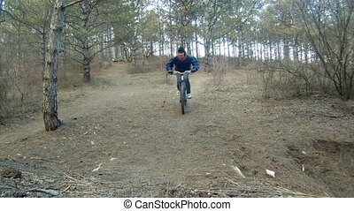 Obstacles on the path - Cyclist surmounting obstacles on his...