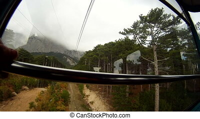 In a gondola - Lifting high above the forest in a gondola