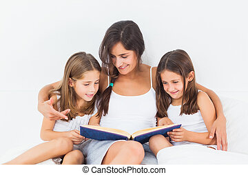 Mother and her children looking at a photo album