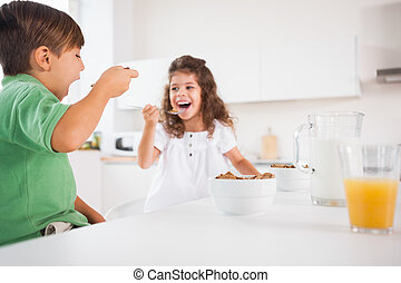 Two children eating cereal