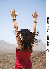 woman arms up - woman opening arms near the teide volcano in...