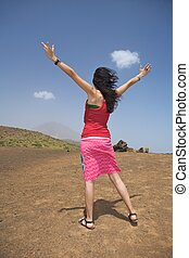 woman greeting a volcano
