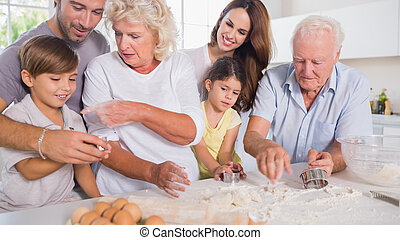 Multi-generation family baking together in the kitchen