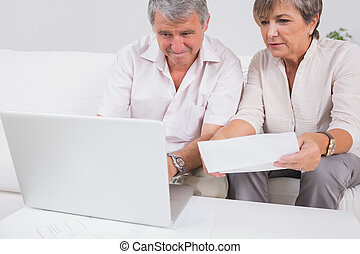 Old couple not understanding the accounts and using laptop...