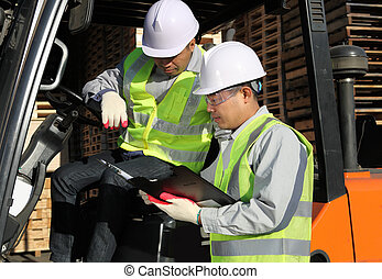 manager talking with forklift operator - manager talking to...