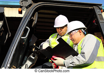manager talking to forklift operator - manager talking with...