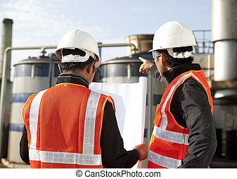 two engineer oil industry - engineer discussion on location...