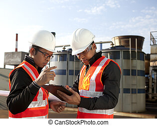two engineer on location site disscution - two engineer on...