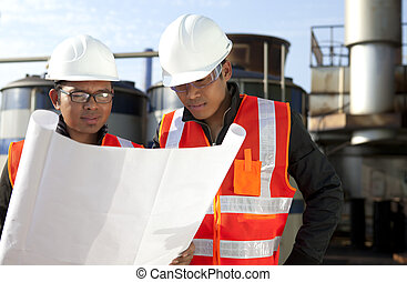 two engineer on location site disscution - two engineer...